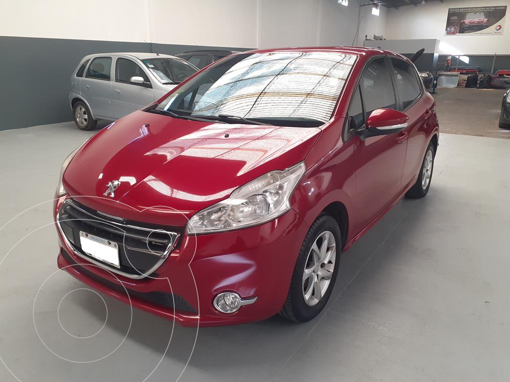 foto Peugeot 208 Allure 1.5 Full  usado (2014) color Rouge Ruby precio $1.636.420