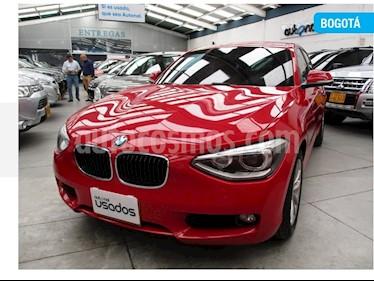 Foto BMW Serie 1 116i 5P Aut usado (2014) color Rojo precio $59.400.000