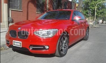 Foto venta Auto usado BMW Serie 1 118i 5P (2012) color Rojo precio $795.000