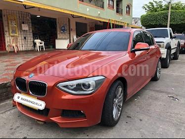 Foto venta Carro usado BMW Serie 1 118i Sport 5P  (2015) color Naranja precio $49.999.999