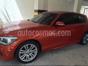 Foto venta Carro usado BMW Serie 1 118iA Sport (2015) color Naranja precio $49.999.999