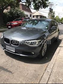 Foto venta Auto usado BMW Serie 1 1.6 AT 5P Kit M (2014) color Gris Mineral precio $9.990.000