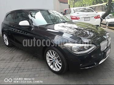 Foto venta Auto Seminuevo BMW Serie 1 3P 118i Urban Line (2015) color Negro Zafiro precio $239,000