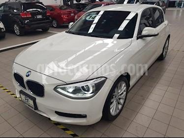 Foto venta Auto usado BMW Serie 1 5p 118i Urban Line L4/1.6/T Aut (2014) color Amarillo precio $249,000