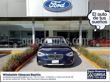 Foto venta Auto Seminuevo BMW Serie 1 5P 118iA Urban Line (2014) color Azul precio $214,000