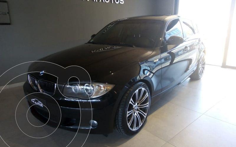 Foto BMW Serie 1 130i Paquete M Sport Package 5P usado (2010) color Negro precio u$s15.000