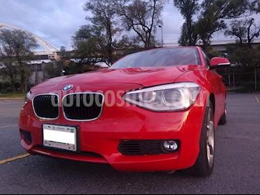 BMW Serie 1 5P 118iA Sport Line usado (2014) color Rojo Crimson precio $215,000