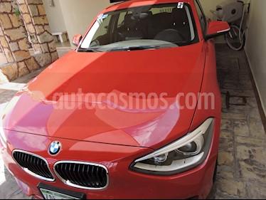 BMW Serie 1 5P 118i usado (2014) color Rojo Crimson precio $210,000