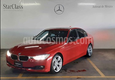 Foto BMW Serie 3 320iA Lujo  usado (2013) color Rojo precio $255,000