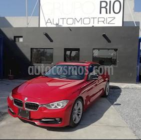 Foto BMW Serie 3 335i usado (2012) color Rojo precio $243,000