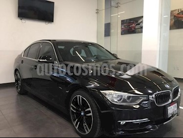 Foto BMW Serie 3 4p 320i Sedan Luxury Line L4/2.0/T Man usado (2013) color Negro precio $259,900