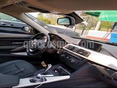 BMW Serie 3 4P 320I TA QC BI-XENON RA-17 usado (2014) color Negro precio $255,000