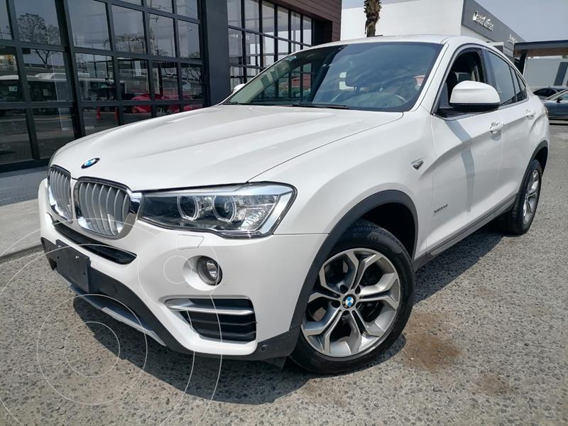 Foto BMW X4 xDrive28i X Line Aut usado (2018) color Blanco Mineral financiado en mensualidades(enganche $142,500 mensualidades desde $13,152)