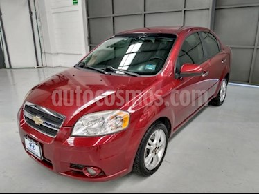 Foto Chevrolet Aveo 4P TM5 A/AC VE F. NIEBLA BA ABS MP3 RA-15 usado (2011) color Rojo precio $100,000