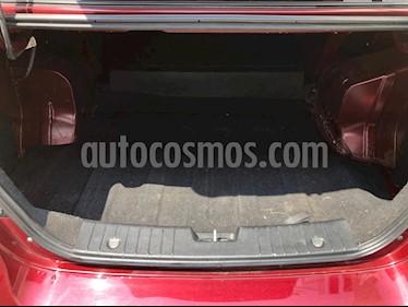 Chevrolet Aveo Paq C usado (2014) color Rojo Merlot precio $100,000
