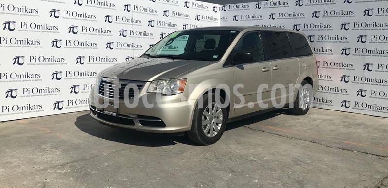Chrysler Town and Country Li 3.6L usado (2014) color Dorado precio $190,000