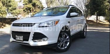 Ford Escape 5P SE PLUS TA A/AC. AUT. PIEL GPS QCP RA-18 usado (2014) color Blanco precio $205,000