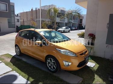 Foto venta Auto usado Ford Fiesta Hatchback SES Aut (2012) color Amarillo Mostaza precio $120,000