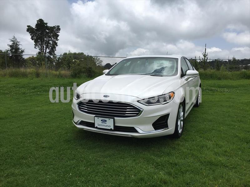 Ford Fusion SE LUX Hibrido usado (2019) color Blanco precio $465,000