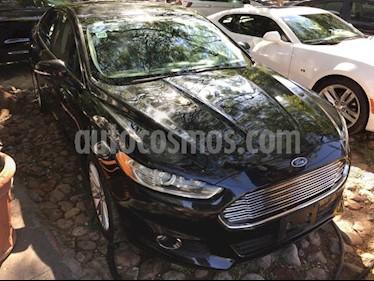Foto venta Auto Seminuevo Ford Fusion SE LUX PLUS NAV 2L GTDI (2014) color Negro precio $240,000