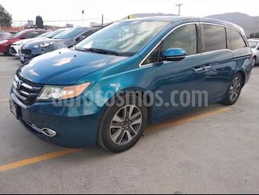 Foto venta Auto usado Honda Odyssey 5p Touring V6/3.5 Aut (2014) color Amarillo precio $310,000