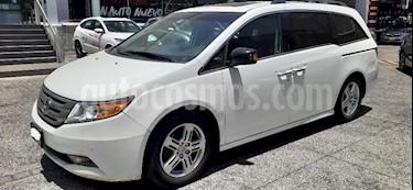 Honda Odyssey 5P TOURING TA A/AC. AUT. QC PIEL CD DVD XENON RA- usado (2012) color Blanco precio $235,000
