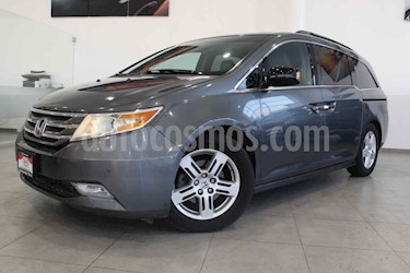 Honda Odyssey 5p Touring minivan aut CD q/c DVD usado (2012) color Plata precio $265,000