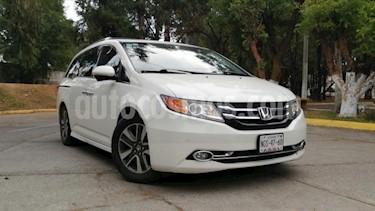 Honda Odyssey 5P TOURING TA A/AC. AUT. QC PIEL CD DVD F. HALOGE usado (2014) color Blanco precio $305,000