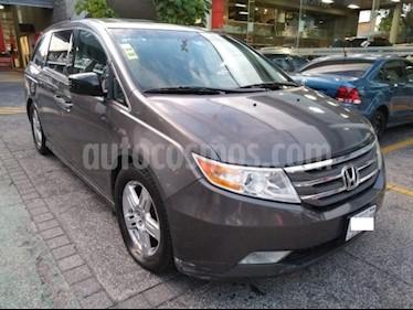 Honda Odyssey 5P TOURING TA A/AC. AUT. QC PIEL CD DVD XENON RA- usado (2013) color Gris precio $251,000