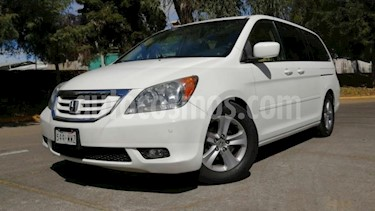 Honda Odyssey 5P TOURING TA QC PIEL 6 CD DVD RA-17 usado (2010) color Blanco precio $165,000