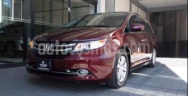 Honda Odyssey 5P EXL TA A/AC. AUT. CD DVD F. HALOGENO RA-17 usado (2016) color Rojo precio $413,000