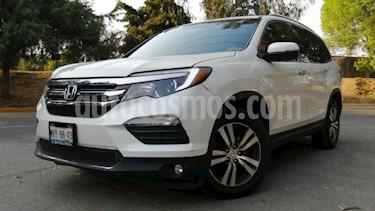 Honda Pilot 5P TOURING TA A/AC. AUT. QCP PIEL MP3 DVD GPS 4X4 usado (2016) color Blanco precio $415,000