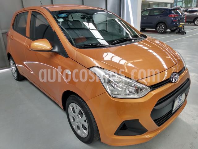 Hyundai Grand i10 5P HB GL MID AT A/AC. R-14 usado (2016) color Naranja precio $136,900