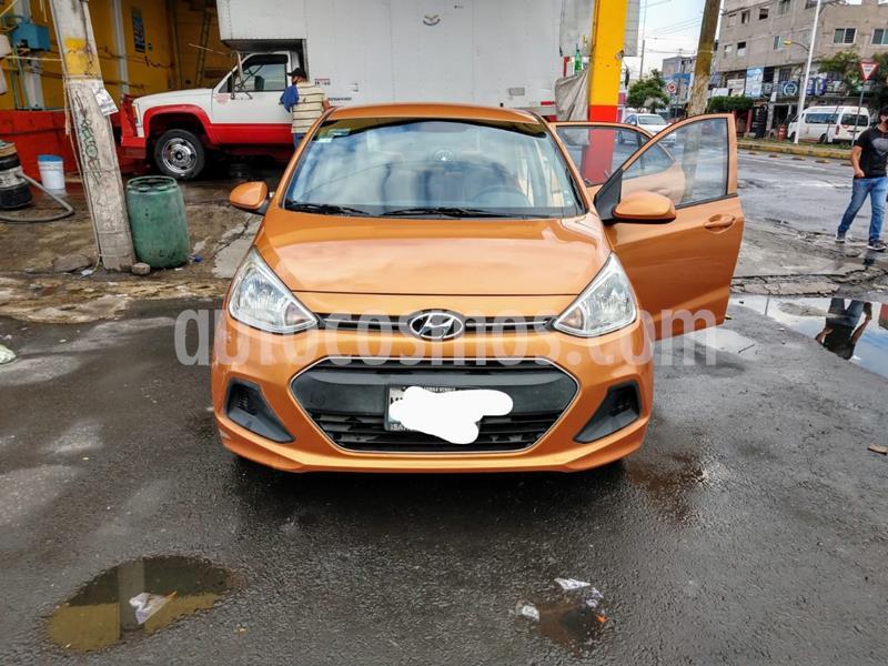 Hyundai Grand i10 GL MID Aut usado (2016) color Naranja precio $125,000