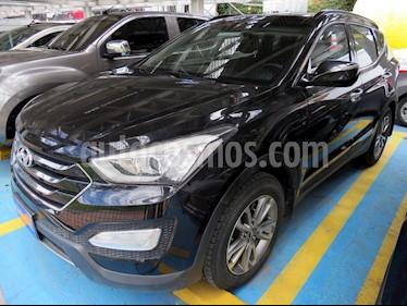 Foto venta Carro usado Hyundai Santa Fe 2.4 4x4 7 Pas. (2014) color Negro precio $68.900.000