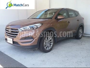 Foto venta Carro usado Hyundai Tucson 2.0 4x2 Aut (2016) color Ocre precio $68.990.000