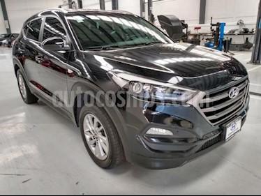 Hyundai Tucson 5P GLS PREMIUM TA A/AC. F. NIEBLA RA-17 usado (2017) color Negro precio $300,000