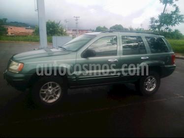 Foto venta carro usado Jeep Grand Cherokee Limited 4.7L Aut 4x4 (1999) color Verde precio BoF2.500