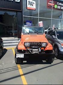 Foto venta Auto Seminuevo Jeep Wrangler X 4x4 4.0L Techo Lona (1995) color Naranja precio $145,000