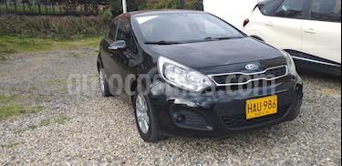 Foto venta Carro usado KIA Rio 1.4L Spice Full Aut (2013) color Negro precio $32.500.000