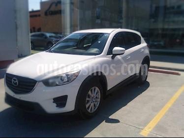 Mazda CX-5 2.0L i usado (2016) color Blanco precio $240,000
