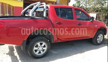 Foto venta Auto usado Mitsubishi L-200 2.5 Work CRM Diesel 4X2 (2013) color Rojo precio $7.500.000