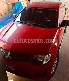 Mitsubishi L200 4x2 2.4L Cabina Doble usado (2011) color Rojo precio $160,000