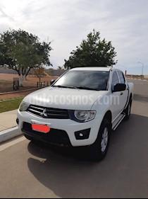 Foto venta Auto usado Mitsubishi L200 4x2 2.4L Cabina Doble (2015) color Blanco precio $210,000