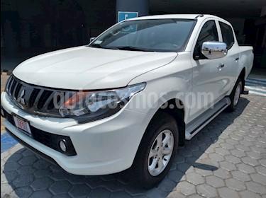 Foto venta Auto usado Mitsubishi L200 4x4 2.5L DI-D Cabina Doble (2018) color Blanco precio $370,000