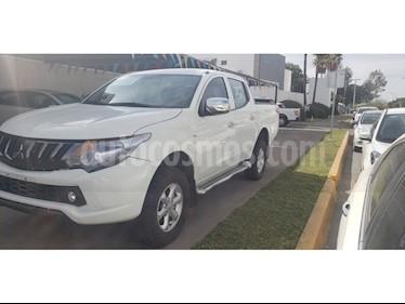 Foto venta Auto usado Mitsubishi L200 4x4 2.5L DI-D Cabina Doble (2017) color Blanco precio $319,000