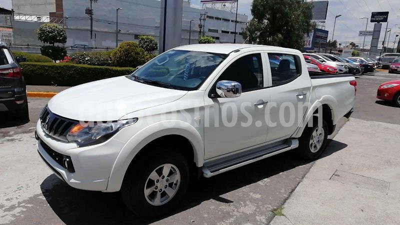 Foto Mitsubishi L200 4x2 2.4L Cabina Doble usado (2018) color Blanco precio $279,000