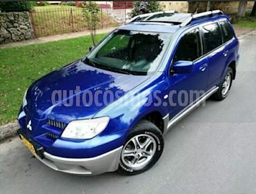 Foto venta Carro usado Mitsubishi Outlander 2.4L 4x4  (2007) color Azul Cosmico precio $31.500.000