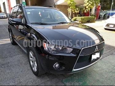 Mitsubishi Outlander 5P LIMITED V6 TA A/AC 3RA FILA VE 6 CD PIEL QC 7  usado (2011) color Negro precio $183,000