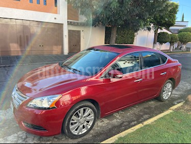 Nissan Sentra Exclusive NAVI Aut usado (2015) color Rojo Burdeos precio $165,000